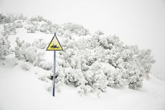 Snow mobile warning sign in winter time Royalty Free Stock Photos