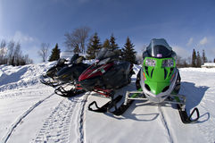 Snow Mobiles. 4 snowmobiles in a line Stock Image