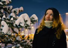 Snow model. A model in the winter next to  a tree covered in snow Royalty Free Stock Images