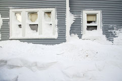 Snow mount piled under residential windows. A huge snow mound piled under residential windows in the aftermath of the Blizzard of 2013 in Worcester Royalty Free Stock Image