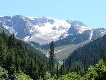 Snow on mountain. Rocky mountains (Canada) in August Stock Image