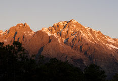 Snow mountain. Locating between 10004'-10016'east longitude and 2703'-2740' north latitude, Jade Dragon Snow Mountain (Yulong Mountain) is the southernmost Stock Images