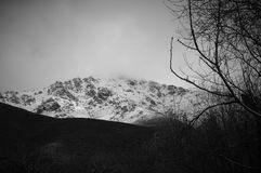 Snow mountain in black and white. Black and white capture of a mountain covered by snow. The photo was take at Prespes region in Greece Royalty Free Stock Photography