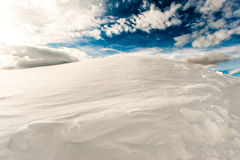 Snow mountain and blue sky. A snow mountain with a blue sky and clouds Royalty Free Stock Photos
