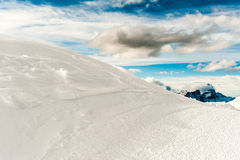 Snow mountain and blue sky. A snow mountain with a blue sky and clouds Stock Photography