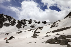 Snow mountain and blue sky with clouds at spring day Royalty Free Stock Photos