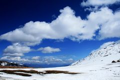 Snow mountain ,blue sky and  white cloud Stock Photo