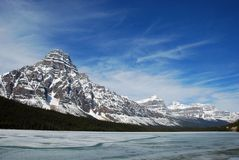 Snow mountain and Bow lake. Snow mountain peaks near Bow lake royalty free stock photography