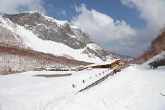 Snow mountain and cabin Stock Photos