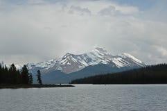 Snow mountain and calm lake Royalty Free Stock Photo