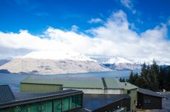 The Snow mountain clouds with blue sky at Queenstown, New Zealand. Stock Images