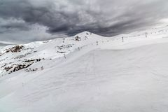 Snow mountain with a cloudy sky Stock Photo