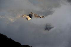 Snow mountain flowing in cloud. (fog) with sunrise Royalty Free Stock Images