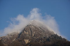 Snow Mountain in the fog Stock Images