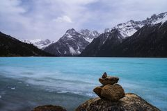 Frozen lake in early spring. Snow mountain , frozen lake , the early spring scenery of the qinghai-tibet plateau.  Yilhun Lhatso lake , SiChuan province , china Stock Images