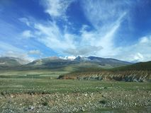 Snow mountain, grassland and blue sky in Tibet, China stock photo