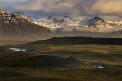 Snow mountain and green valley Stock Image
