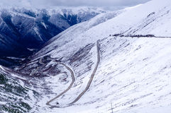 Snow mountain and highway Royalty Free Stock Images