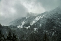 Snow on the mountain hills in ustria in spring Stock Images