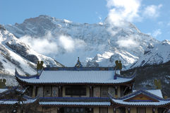 Snow mountain and Huanglong temple Stock Photo