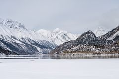 Snow mountain and ice lake in winter Royalty Free Stock Photography