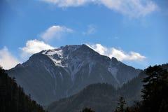 The snow mountain im Jiuzhaigou. The name jiuzhaigou refers to the 9 tibetan villages that are situated in the valley Stock Photos