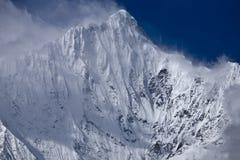Snow mountain, kawagebo. Kawagebo, 6740 meters high, in yunnan province, china. it is virgin until now Stock Photos
