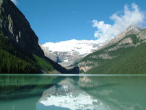 Snow mountain in Lake Louise. Canada.  It is very early in the morning and the moon is still there Royalty Free Stock Images
