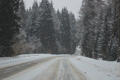 Snow mountain panorama and snow road Stock Images