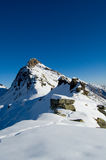 Snow mountain peak. Peak and snow flat plane, almost a macro.Blue sky Royalty Free Stock Photos