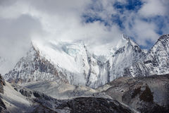 Snow Mountain peak with cloud in Yading nationa Royalty Free Stock Images