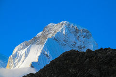 Snow mountain peak. Mountain peak with snow and ice. Snow and glacier in the high mountains of Huascaran, Peru Stock Images