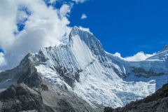 Snow mountain peak. Mountain peak with snow and ice. Snow and glacier in the high mountains of Huascaran, Peru Stock Image
