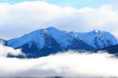 Snow mountain peak over te anau lake fiordland national park sou Stock Photo