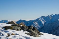 Snow mountain peak panorama. Peak and snow flat plane, almost a macro.Blue sky Stock Photo