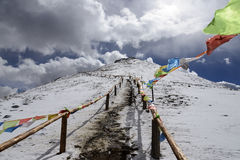 Snow mountain and prayer flag Royalty Free Stock Photography