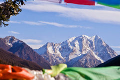 Snow mountain through Prayer flag Stock Photo