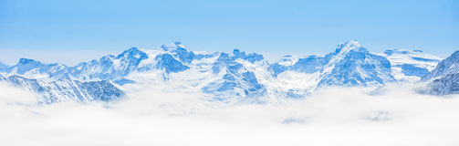 Snow Mountain Range Landscape with Blue Sky Stock Images