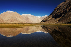 Snow mountain range and reflection Leh Ladakh ,India Stock Images