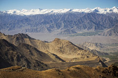 Snow mountain range at road side viewpoint on the way to Khardung La from Leh LADAKH, INDIA Royalty Free Stock Photography