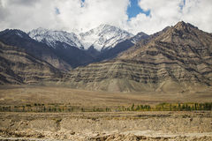 Snow mountain range on the way to Hemis monastery from Leh Stock Images