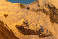 Snow mountain ridge in Alps at sunset Royalty Free Stock Images