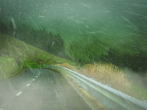 Snow on a mountain road. Snowfall on a winding mountain road in Europe Royalty Free Stock Images