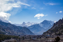 Snow mountain and rural region landscape with clear blue sky Royalty Free Stock Photo