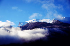 Snow mountain and the sea of clouds in Tibet Stock Photo