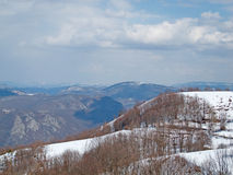 Snow mountain slopes in a sunny, winter day Stock Photography