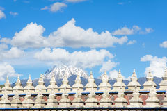 Snow Mountain and stupas Royalty Free Stock Image