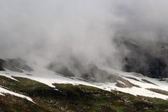 Snow. Mountain on a Sunny Day Fog Stock Photo