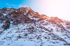 Snow mountain at sunrise Stock Images