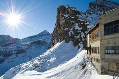 Snow mountain sunshine. Peak and snow flat plane.Blue sky with sunshine star.cableway station Stock Image